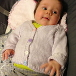 Rowen loves the cardigan her grandma made for her.